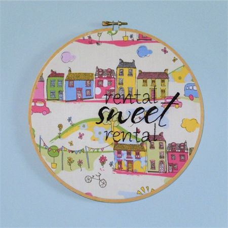 'Rental Sweet Rental' 8'' embroider on to vintage fabric and mounted on an embroidery hoop ready for display.