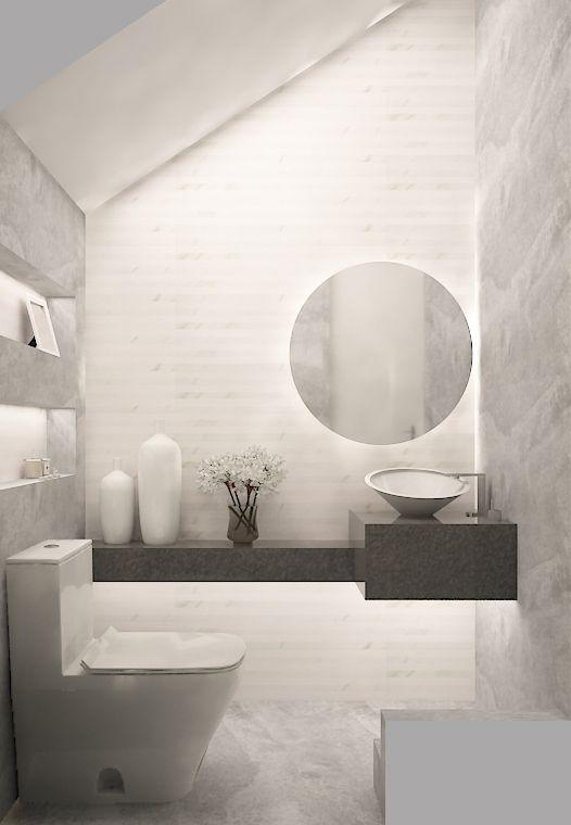 medio baño, baño pequeño, cubierta granito gris oxford, espejo redondo, nichos iluminados, sanitario blanco, muro tipo piedra color gris, baño contemporaneo