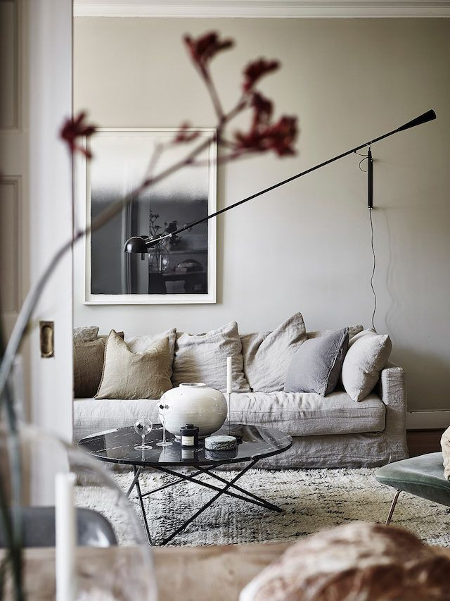 Linen sofa in a beautiful Swedish space with autumn tones / Entrance.