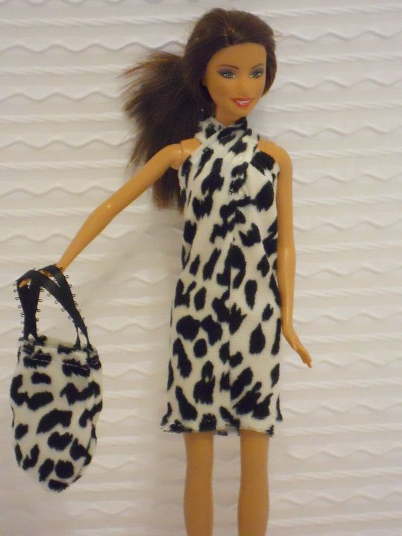 Barbie Clothes Barbie Dress in Black & White Knit by BarbiesRUs, $4.00, Barbie dress in black & white knit makes a great first fashion. Barbie dress is designed to pull on easily and has straps that velcro in the back. Barbie dress can be worn with the straps crossed or uncrossed to give a little bit different look as shown in the photos. Barbie dress is very soft and has a matching purse in the popular rounded design with black satin ribbon handles.