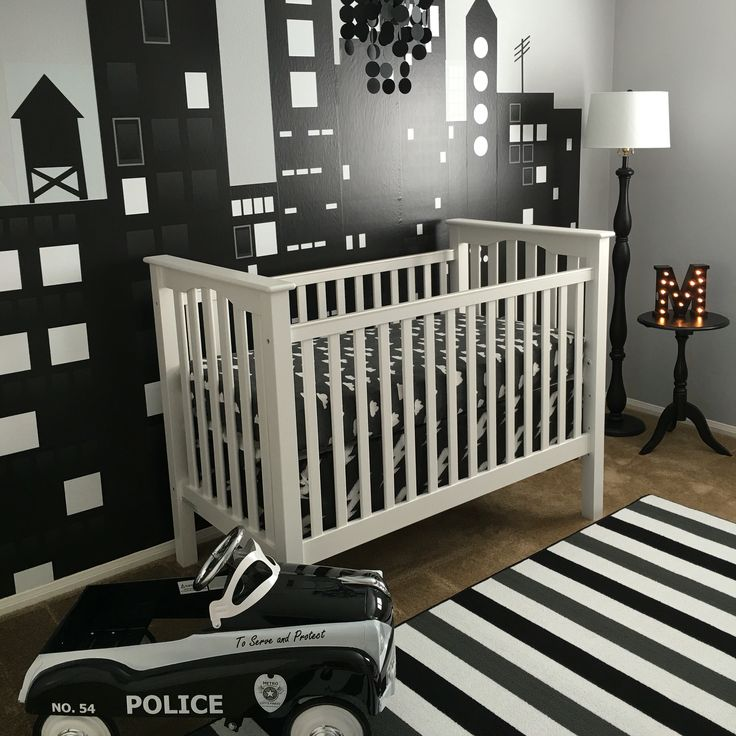 Navy city wall with navy stripe rug from bathroom