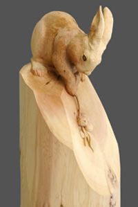 """Title: """"Rabbit with blue berry branch""""  Material: Western red cedar  Size: WxHxD12"""" x 24"""" x 12""""  : 30cm x 60cm x 30cm"""