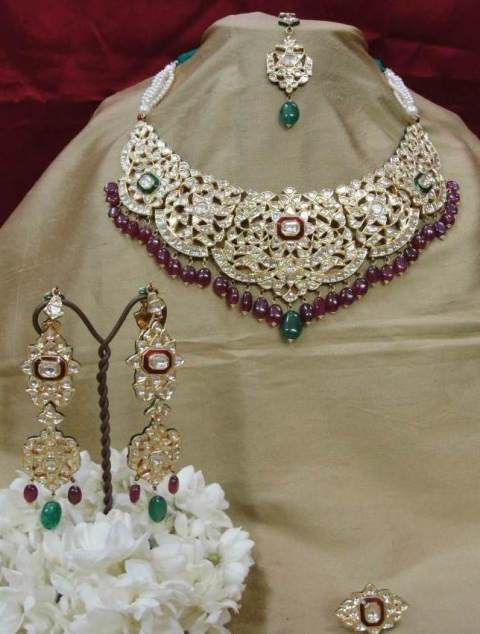 Regal kundan bridal set – Traditional Indian necklace, earrings, tikka and ring suite handcrafted in the age-old 'kundan' style of jewellery...