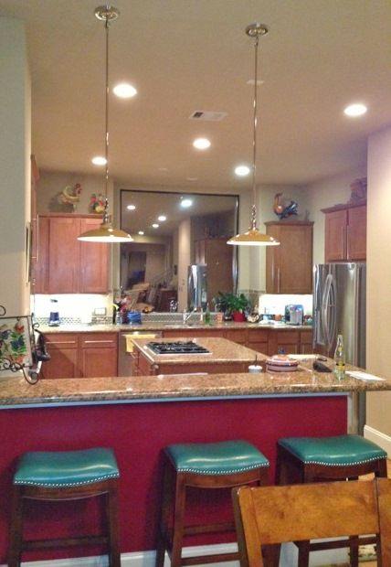 Stem loop pendants lend art deco vibe to texas kitchen