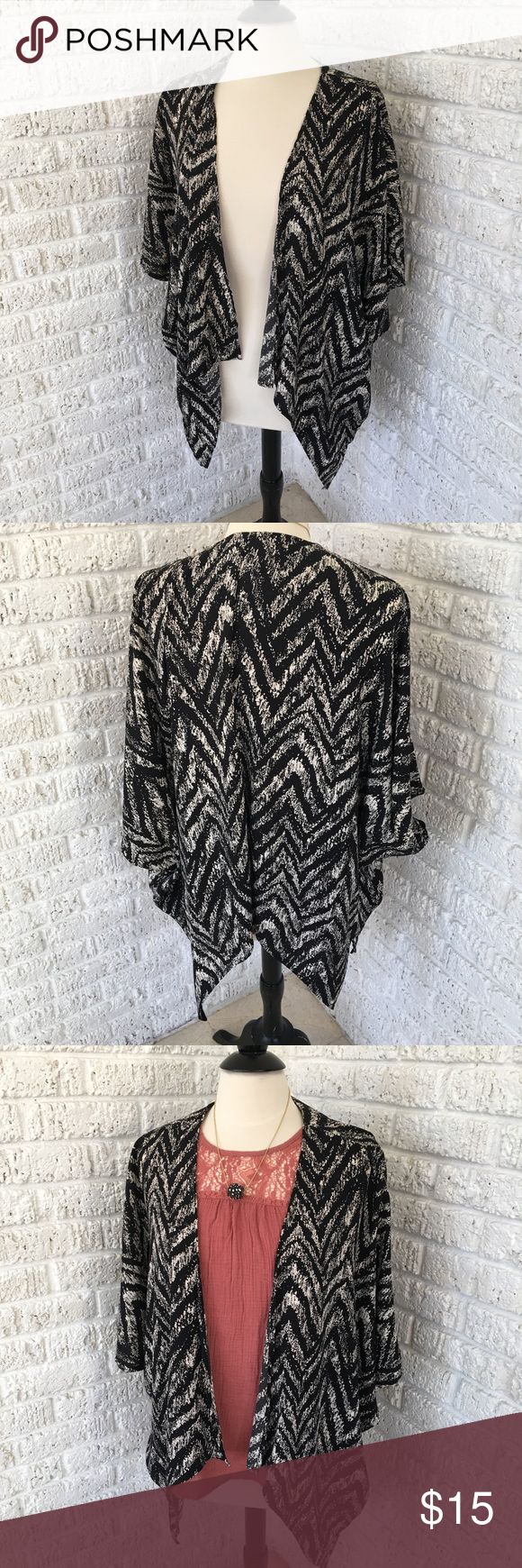 Black & white geometric pattern Boho Kimono shrug Black and white patterned batwing style kimono shrug. Square when flat. 100% polyester. Very light and comfortable. Easily styled with a simple top and leggings. Size Large. painted threads Tops Tunics