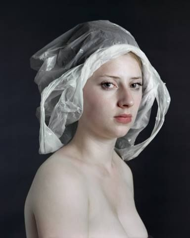 "Photographer Hendrik Kerstens is not just imitating Flemish Paintings. As the series progressed, he became increasingly interested in creating a conceptual dialog between past and present. The titles give the game away. ""Napkin"" looks like a maid's bonnet. In ""Bag"", a plastic grocery bag is shaped to look like a lace hood."