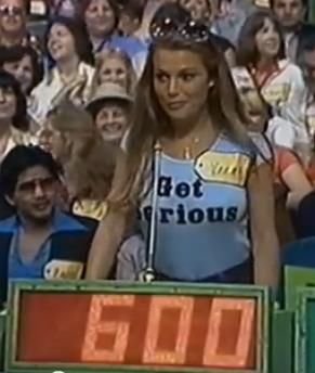 "A young Vanna White as a contestant in The Price is Right before ""turning letters""."