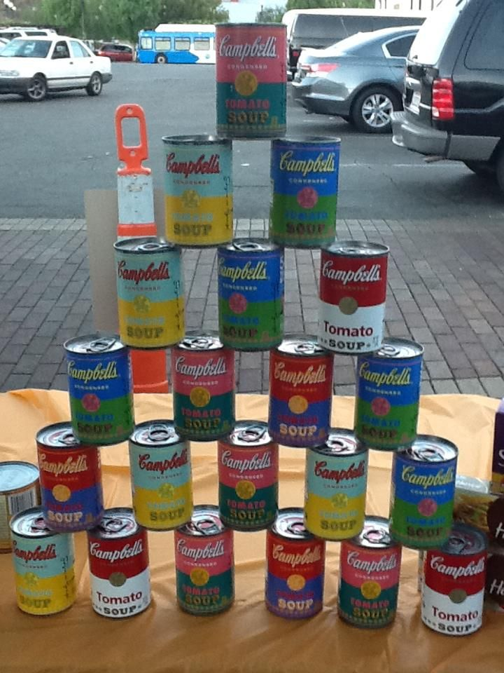 great idea for andy warhol art lesson.  maybe make copies of a campbell soup label and have kids color them then arrange for an awesome picture.  could go along with them drawing their own can picture as well.  black marker and crayons.