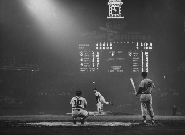 Ted Williams awaits his turn at the plate in old Comiskey Park during a game against the Chicago White Sox.