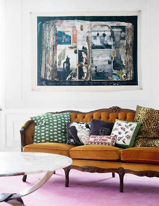 a victorian tufted sofa mixed with modern art and a plethora of print pillows, via josef frank via sköna hem.