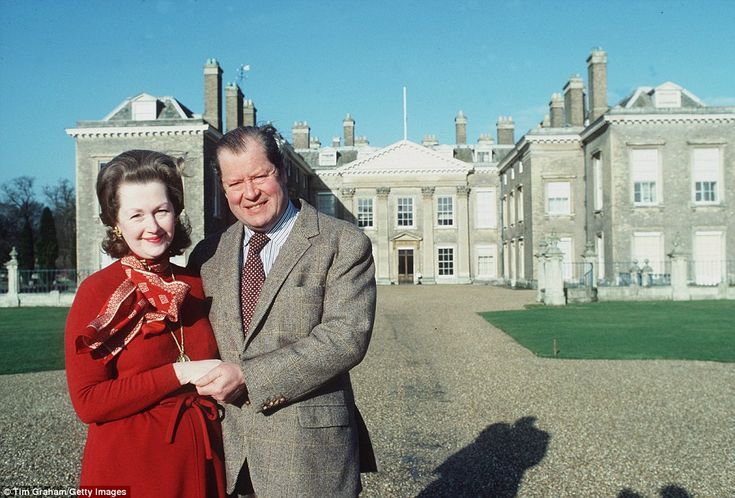Earl Spencer and his wife Raine, who died today, are pictured outside their home of Althorp House in Northamptonshire