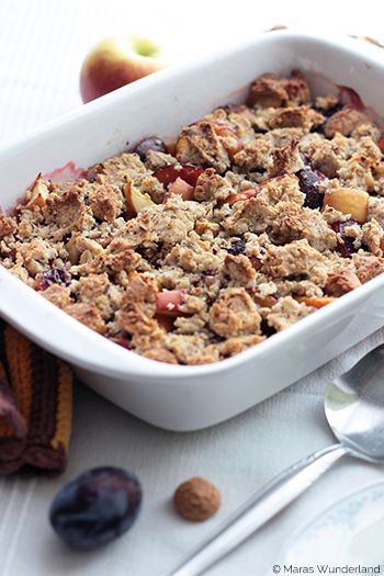 Autumnal crumble with plums and apples