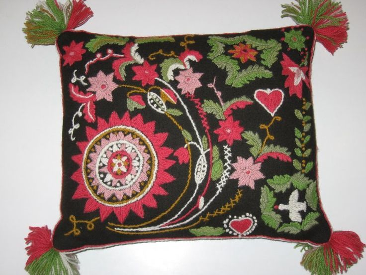 The Blomsteryra cushion, traditional Swedish cushion with wool embroideries on wool fabric from Scania (Skåne) province. Design by the Swedish National Crafts Association, the Skåne province department. Cushions like those were used to sit on when went with horse carriage, for example to church. Nowadays used as interior cushions.