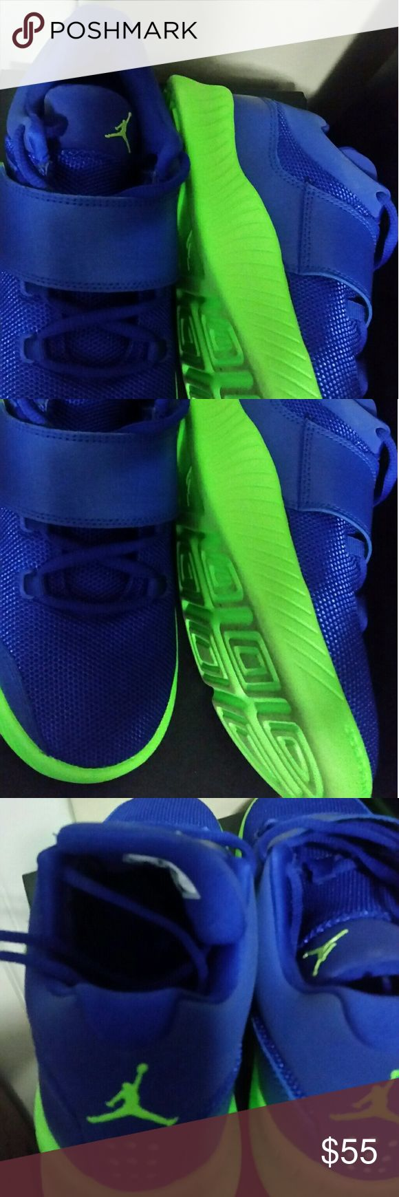 Blue and neon green Jordans Blue and green Jordan J23 shoes. Good for cross training and stlye. Size 5.5 y boys (size 6 women's) Jordan Shoes Athletic Shoes