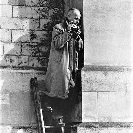 the creepy dude on the ladder is Henri CARTIER-BRESSON. France. Paris. Photo Dan BUDNIK D.R. 1961