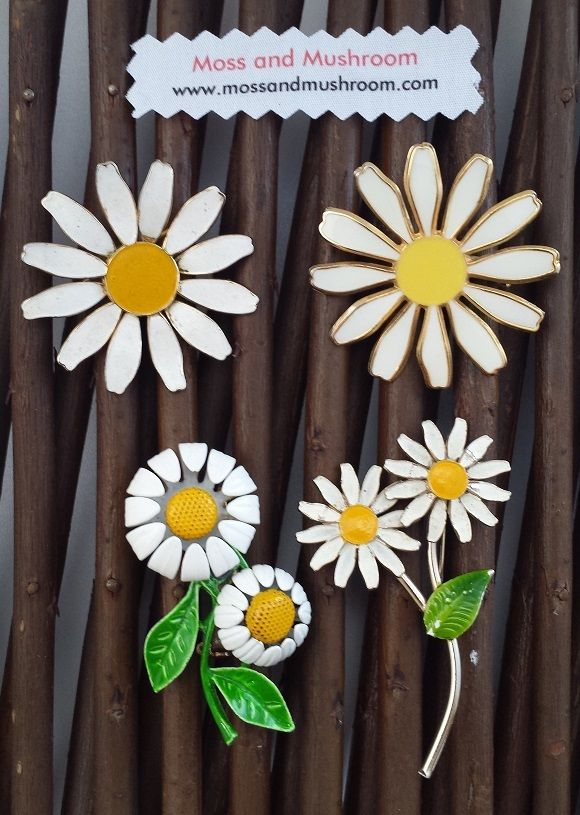 High quality vintage daisy motif brooches to wear on your favourite dress or jacket, or to add to your bespoke brooch bouquet.The 4 brooches in this collection are all approx. 1.5inch/4cm wide but vary in length. They're great to fill the small spaces in your bouquet, or as features in bridesmaid/flower girl posies or corsages.The brooches in this group start from just €6.00   P