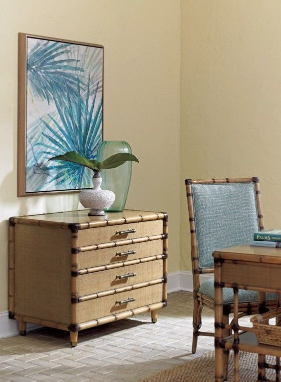 Lighten up! Make your home office as bright and breezy as the rest of your home with this gorgeous, tropical style file chest. This office storage piece is the perfect match for your fun-loving, globe-trotting personality with its destination resort inspired carved bamboo mouldings and woven raffia panels. Contains ample storage for your office supplies and important documents with one file and two storage drawers.