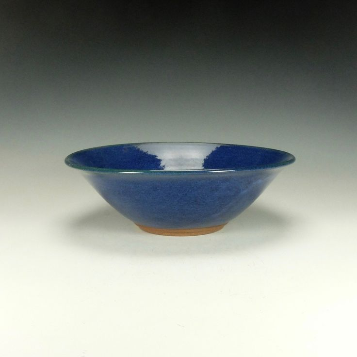 """Stoneware salad bowl. Wheel thrown stoneware salad bowl. Cobalt blue glossy glaze. Lead-free, oven, microwave and dishwasher safe. The image is of the actual piece for sale. Signed on the bottom by the artist. The bowl is approximately 4"""" high x 11.75"""" diameter. Ready to ship."""