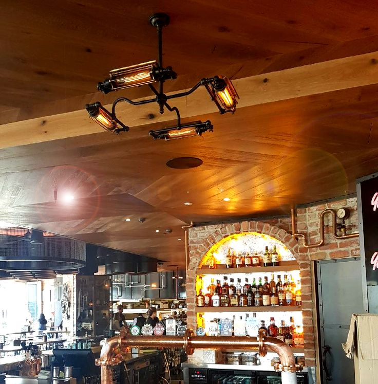 Cage horizontal tube pendant pictured insitu at the Loose Moose.