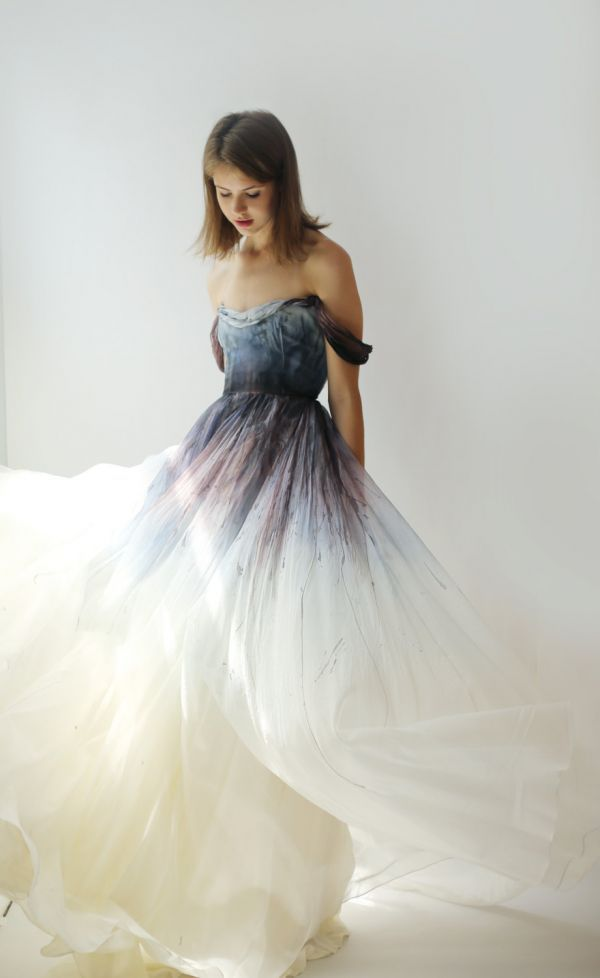 Crafted out of fluid silk organza, this beautifully unconventional bridal gown is hand-dyed and hand-painted in a painstaking nine-step process. Reflective of a stormy seascape, the colors range from deep eggplant to sky blue.