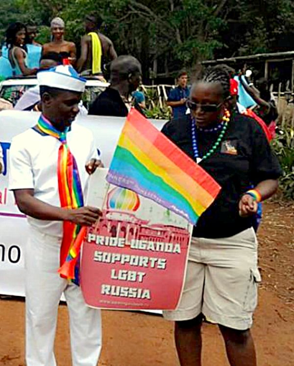 If this doesn't move you and bring a tear to your eye, please check your pulse. A demonstration of solidarity with their brothers and sisters in Russia by LGBT Ugandans. There is a very real possibility of their being beaten to death for coming out in public, yet here they stand. Profiles in courage.