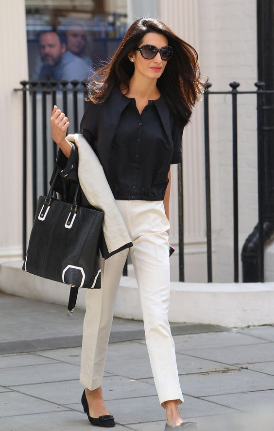 white trousers with a black top and bag
