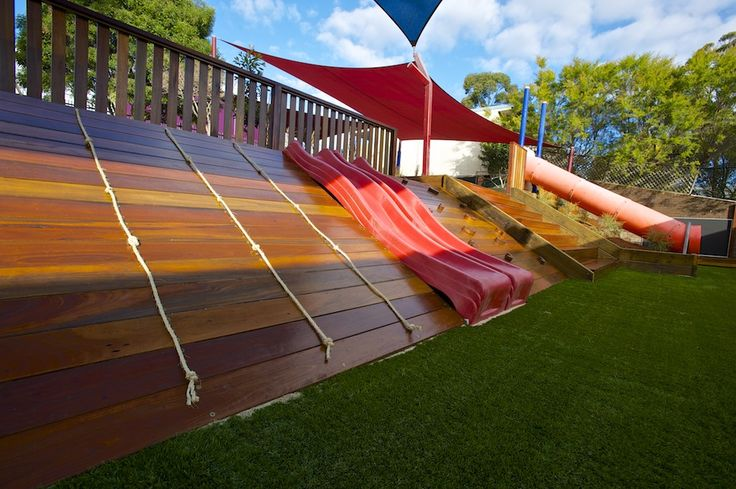 Innaburra Anglican College Preschool Bangor, Sydney, New South Wales. Preschool playspace, After, 2012. Middle and lower tiers. The slope between the middle and lower tiers is now has two separateclimbing areas, (ropes and a climbing wall) adoubleslide and a tunnel slide.