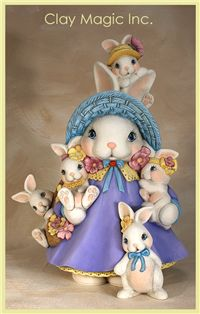 Coelha mamãe e filhotinhos.