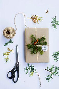 Add greenery to gift wrap.