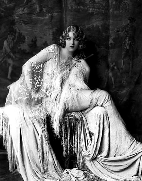 """Onsite Muse: The roaring 20s - When shoe sales soared, because hem lengths shortened!  Long """"Victorian"""" hair was cropped into precision bobs, and a ruby red lip color called, """"Ox blood"""" was the rage.  It was a rebellious look at first, but so chick, that it swept the world and has survived as pure and wonderfully classic: The Flapper."""