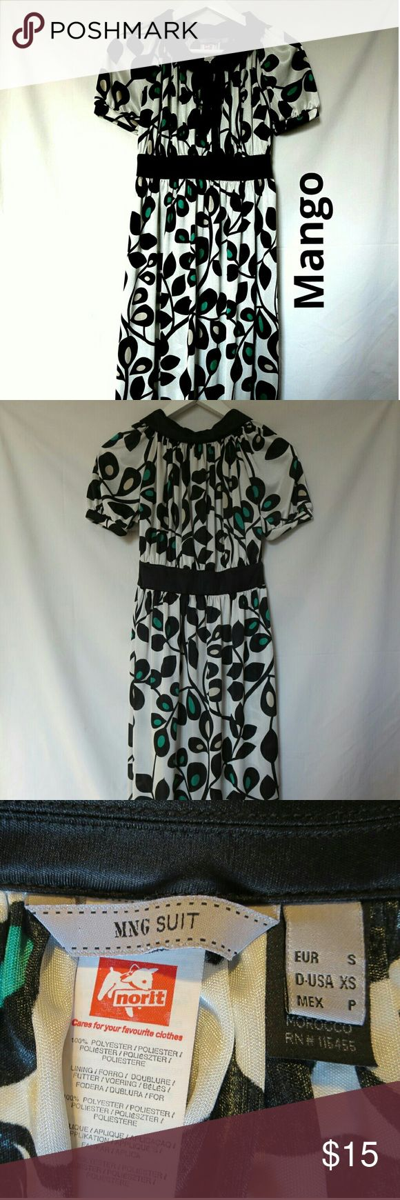 "Mango Suit Size XS Midi White Dress All year round dress!!! Great w sandals in summer, w boots and a cardigan in winter. Total length 47"". Black, green, tan leaf patterned. 5 buttons & black ribbon neck closing. Open to all reasonable offers & questions. Happy shopping :) Mango Dresses Midi"
