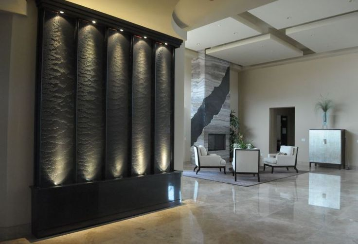Indoor water wall with dramatic flair 10 Rooms with an Indoor Water Feature