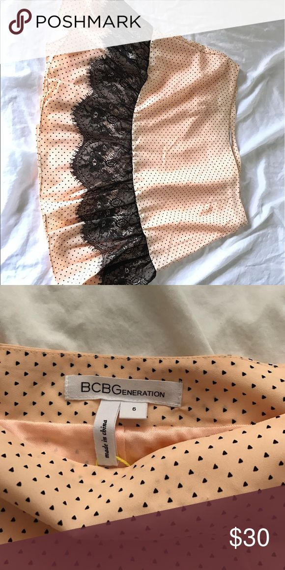BCBGenerarion skirt BCBGeneration skirt in peach with tiny black triangles all over and a black lace trim on the ruffle. Has never even been worn! BCBGeneration Skirts Mini
