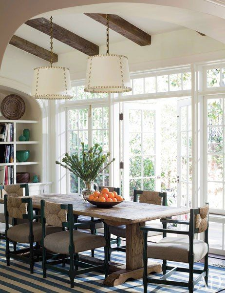 Love all of the natural light, the doors to the backyard and the chairs... table is pretty awesome too