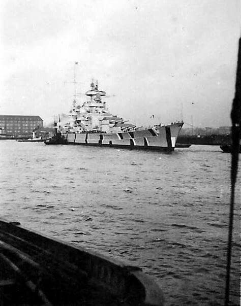 Little known picture of 11 in Scharnhorst in Baltic camouflage scheme, and with turret tops painted red, November/December 1940. Always graded as a battleship by the Germans, and protected as such, the Allies regarded her and sister Gneisenau as battlecruisers on account of their high speed (32 knots) and relatively light gun calibre.