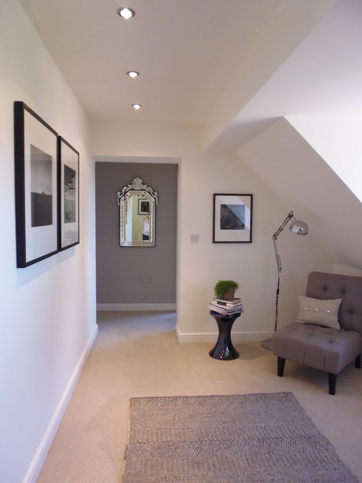 Striking modern landing. Black and White photographic prints by Paul Hart. Walls: Wimborne White and Elephant's Breath