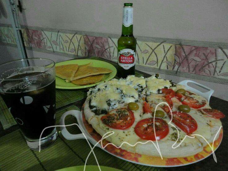 Pizza, fainá, cerveza y fernet