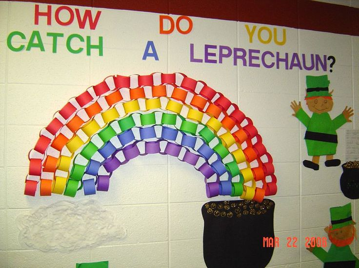 """Love how the paper chains make a rainbow! St Patricks day classroom bulletin board with a leprechaun! """"How do you catch a leprechaun?"""""""