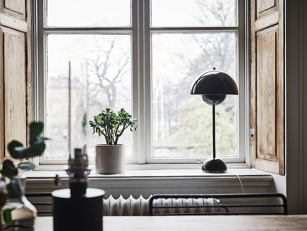 Flowerpot lamp in the window of a  lovely Swedish home. Entrance.