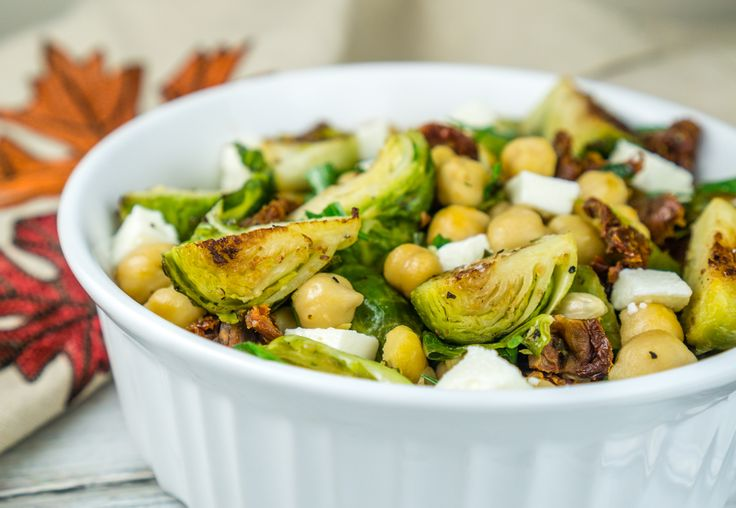 Roasted Brussels Sprouts and Chickpeas Salad with Sun-Dried Tomatoes and Queso Fresco in a lemony dressing. Perfect salad for the colder months!