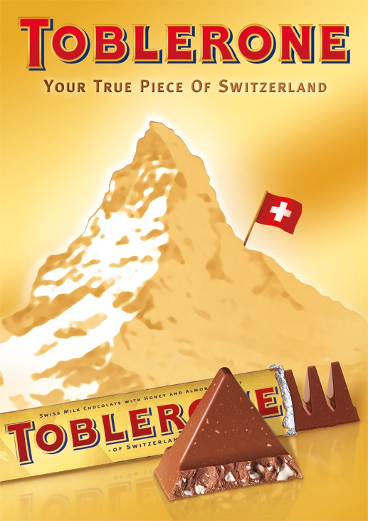 """Toblerone is a popular chocolate bar known for its triangular prism shape. It is owned by Kraft Foods, an American grocery manufacturing and processing company.  Its name is a combination of the Italian word """"torrone"""" (a type of nougat) and its creator Theodor Tobler. He created the Toblerone in 1908 in Bern, Switzerland together with his cousin Emil Baumann. Over 11 variants of Toblerone have been produced since the 1970's."""
