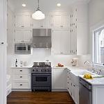 Do not install microwave above stove (difficult to cook on back burners) but rather to its side. ChrDAUER Architects -  stainless steel microwave, built-in microwave, microwave in upper cabinetry