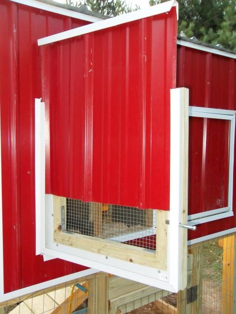 removable door panels for controlling chicken coop ventilation.  Serious forethought here.