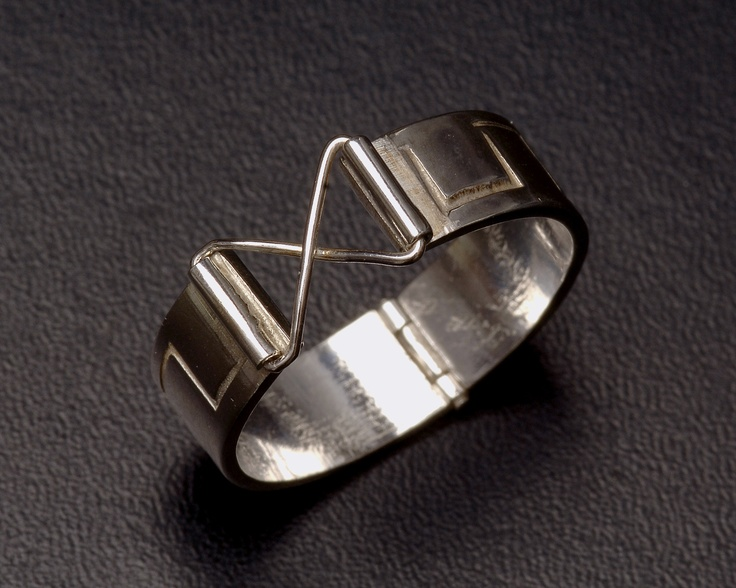 Silver ring with hinges
