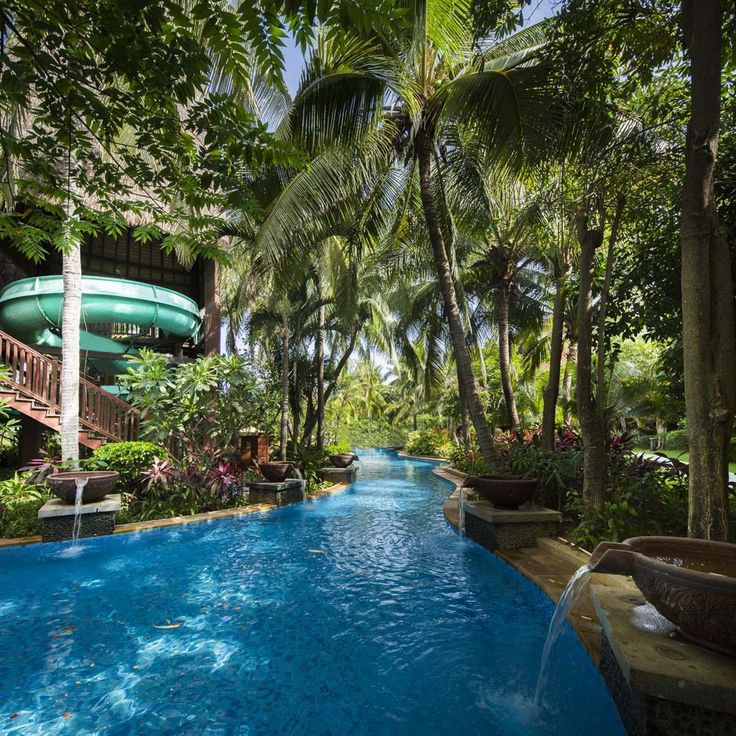 A pool that truly makes you feel like you're in the wilderness. This expansive blue lagoon pool sits beneath the palms, and even has a waterslide for kids.  Location: Main pool, Club Med Sanya, China.