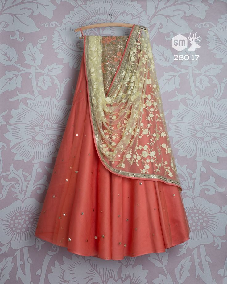 Beautiful blush pink color designer lehenga and floret lata design net dupatta. Lehengas from Swati Manish is well suited for all parties. 05 November 2017