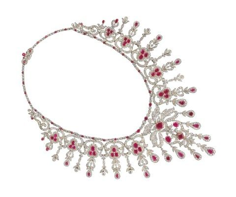A BELLE ÉPOQUE RUBY, SYNTHETIC RUBY AND DIAMOND FRINGE NECKLACE Of openwork scrolling design, set throughout with old-cut diamonds and variously-cut rubies and synthetic rubies, circa 1910, 23 1/4 ins., mounted in silver and gold