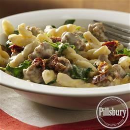 Our recipe for Italian Sausage and Pasta in Basil Cream Sauce is delicious and easy to make! Use uncooked gemelli pasta, spicy Italian pork sausage, Progresso® Recipe Starters® creamy Parmesan basil cooking sauce, Pillsbury BEST™ All Purpose Flour, Crisco® Light Tasting Olive Oil, chopped arugula, and julienne-cut sun-dried tomatoes in oil.