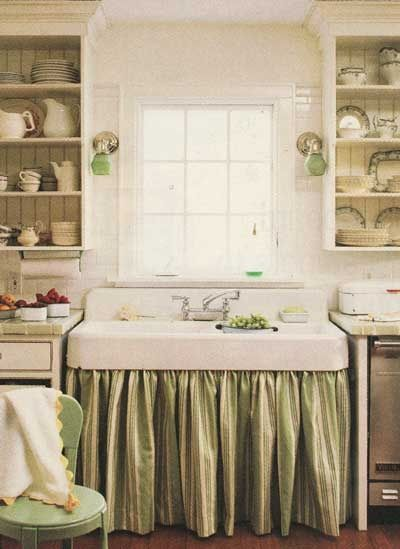 Could use fabric to coordinate sink with cabinets, instead of trying to match a new cabinet to a vintage sink. Love the open shelving framing the sink.