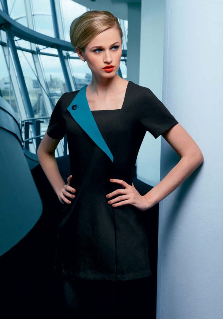 Stylish and smart tunic suitable for many professions including beauty, hairdressing, spa and salon careers. Black beauty tunic with teal contrast lapel. Shop at www.simonjersey.com for beauty tunics, beautician uniforms, beauty therapist's tunic, salon uniforms, spa uniforms, hairdressing tunics. Perfect for many work places including beauty salons, spas, hairdressing salons, cosmetic surgeries, dog grooming salons, hotels, boutique hotels and more.